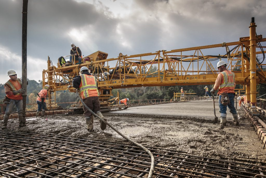 concrete pouring roadway on bridge